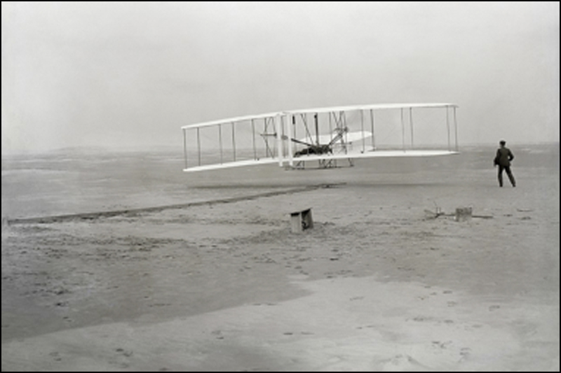 First flight of the Wright Flyer. Orville Wright was piloting; his brother Wilbur was running at win